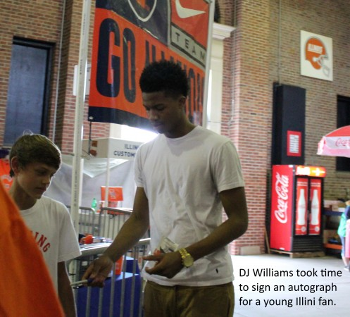 DJ Williams signs an autograph