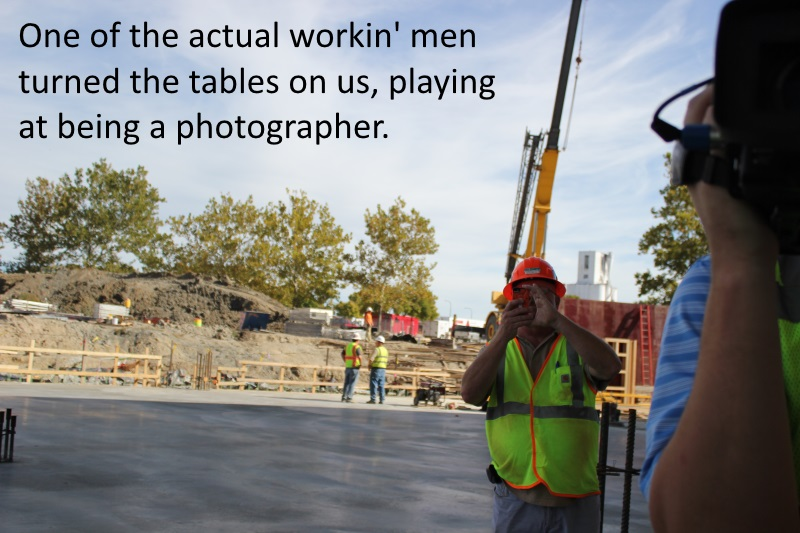 workin man takes picture of media