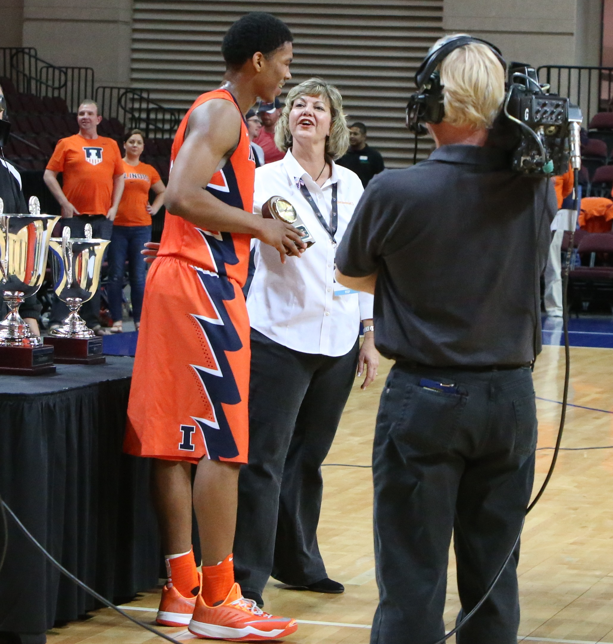 Malcolm accepts all-tourney trophy