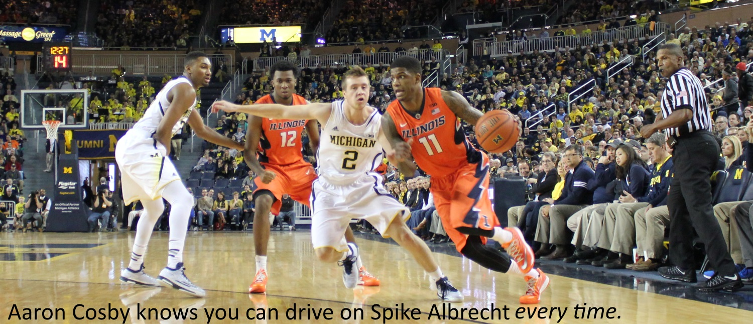 Aaron Cosby drives on Spike Albrecht