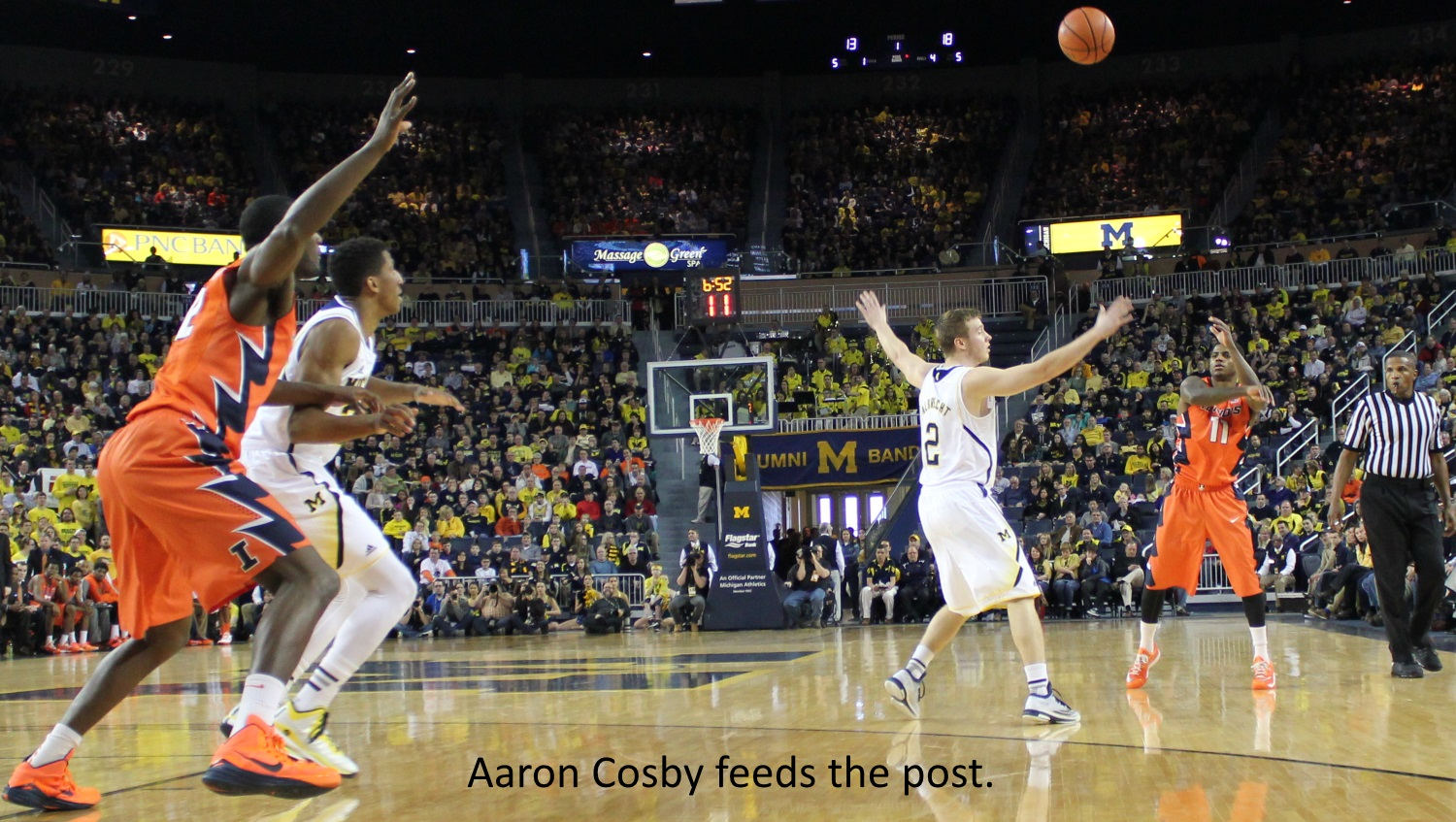 Aaron Cosby feeds the post