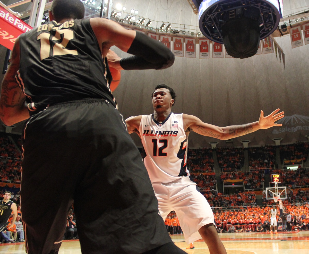 Illinois freshman forward Leron Black defends Purdue's Vince Edwards