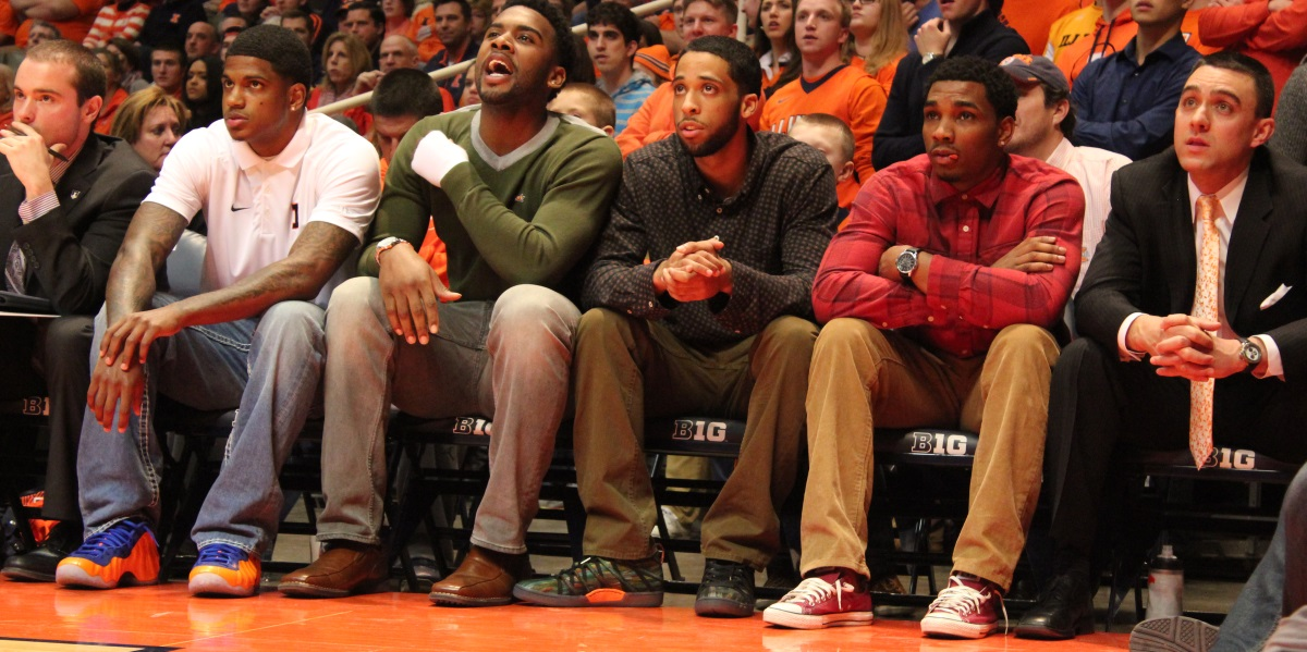 Injured would-be starters Aaron Cosby (white) Rayvonte Rice (green) and Tracy Abrams (red) watch the Illini-Purdue game Wednesday