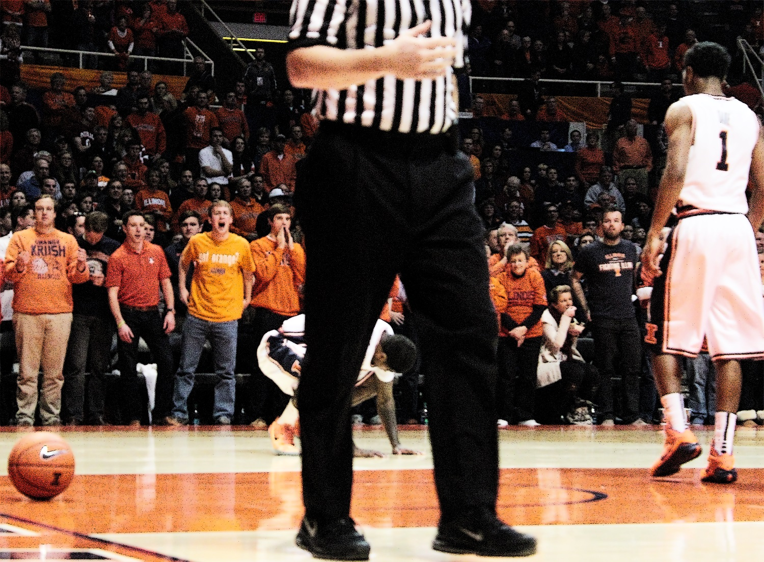 Aaron Cosby covers his face while referee walks away