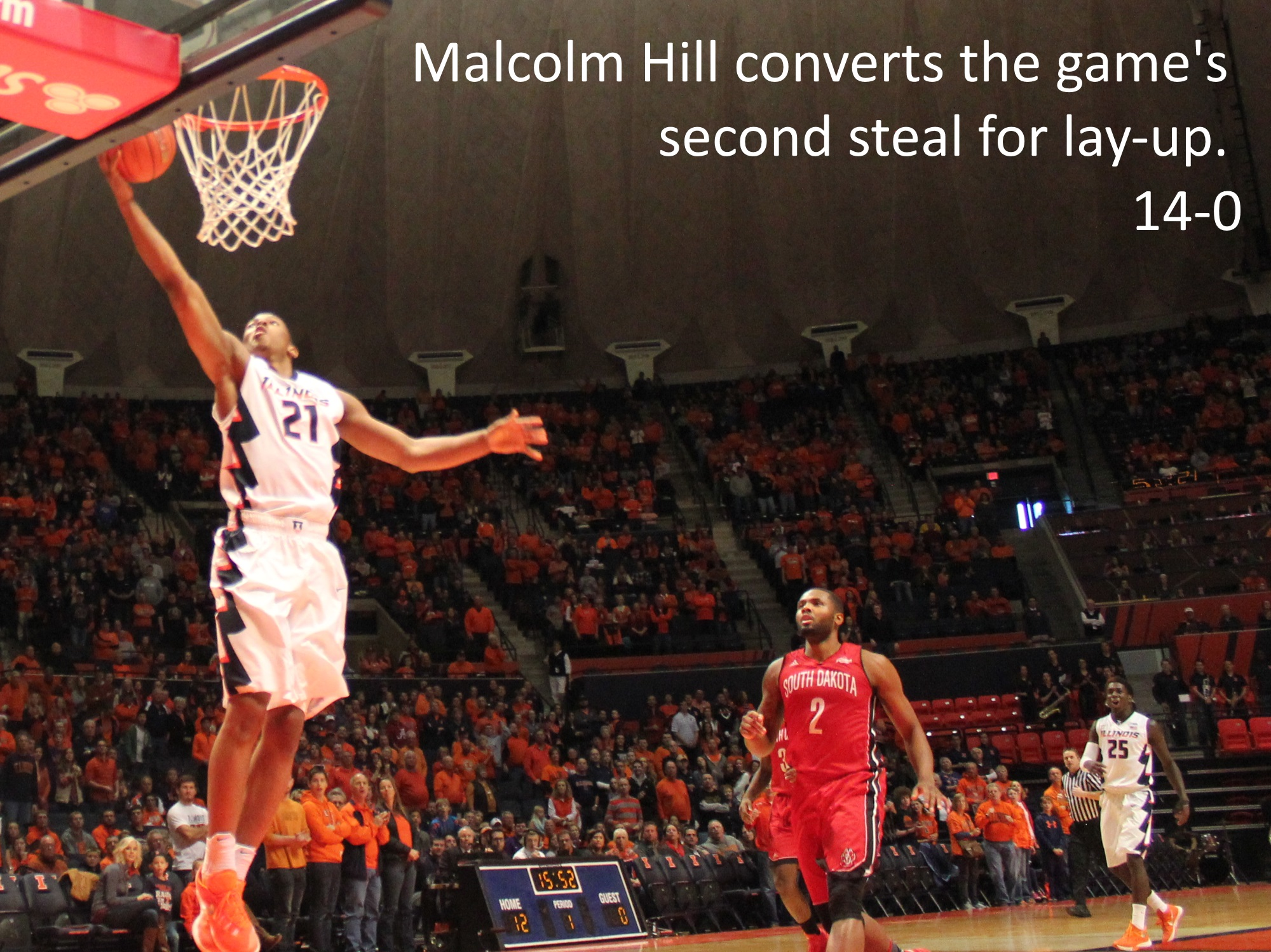 Malcolm Hill converts the game's second steal for lay-up 14-0