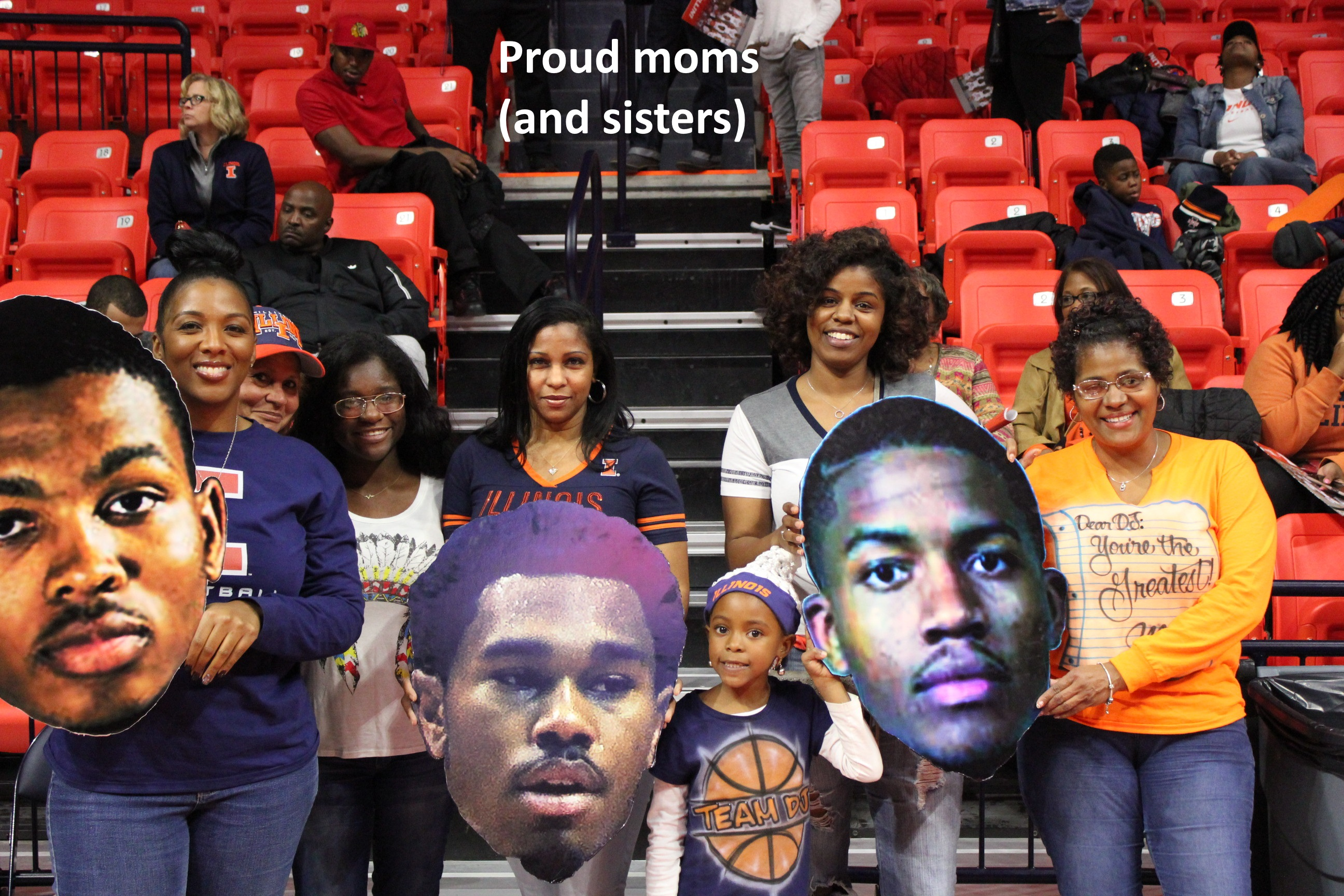 proud-moms-display-giant-heads-of-malcolm-hill-jaylon-tate-dj-williams