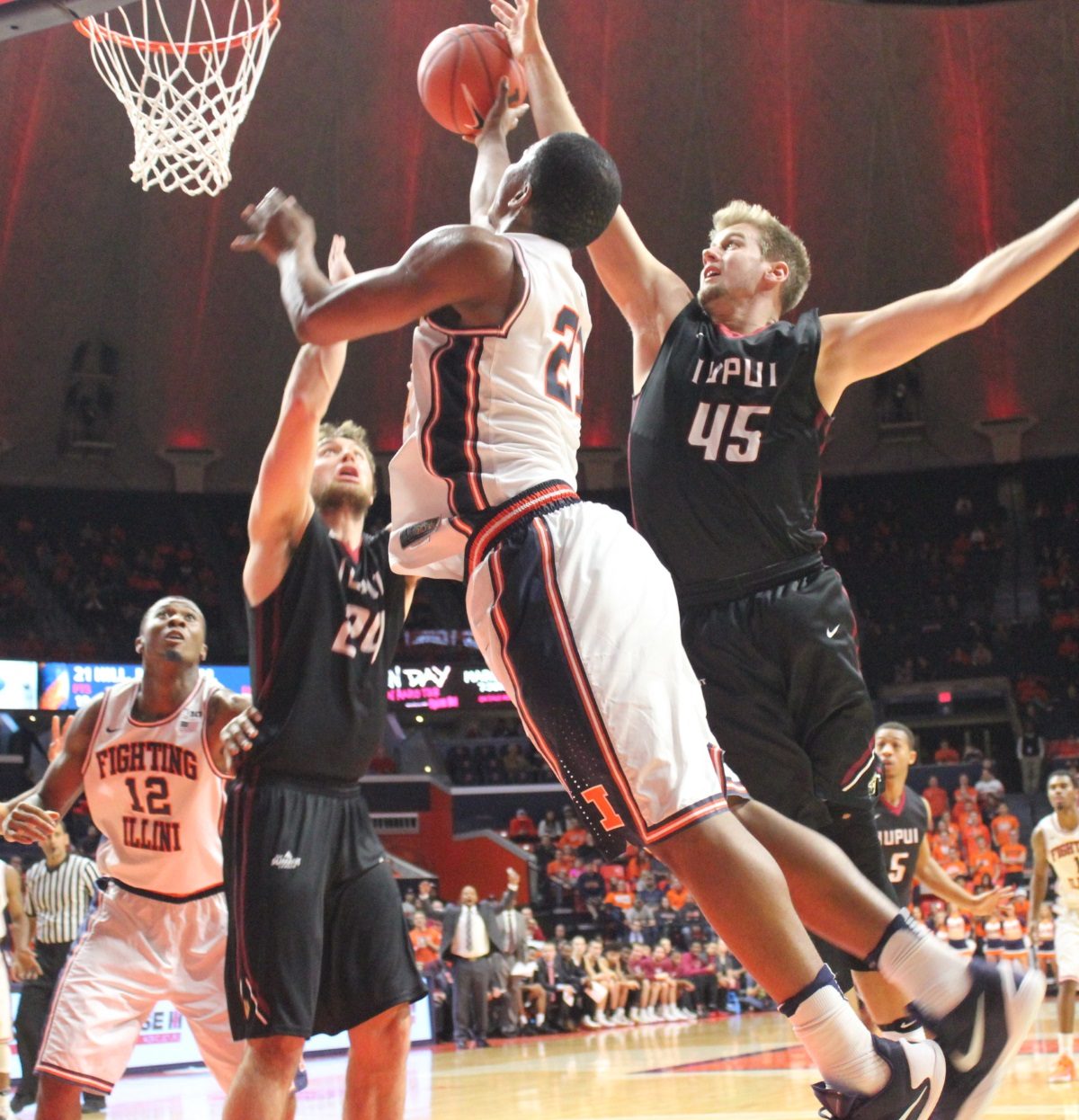 illini-malcolm-hill-tries-to-shoot-over-a-duo-of-iupui-defenders-tuesday-in-champaign