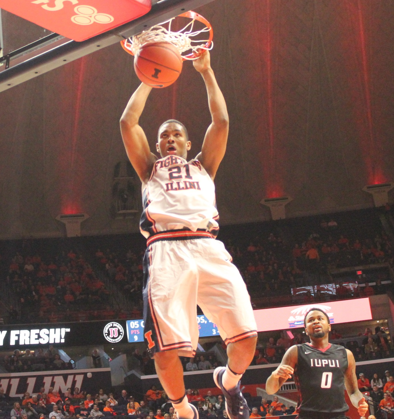 malcolm-hill-punctuates-a-fast-break-while-iupuis-darell-combs-can-only-watch